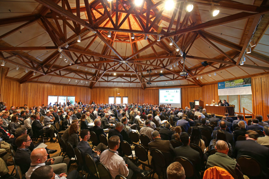 Crowd inside of World Forestry Center for the Who Will Own the Forest? Conference