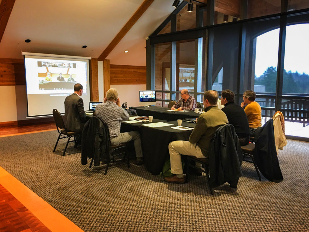 Six guests attend a business meeting in the Mount Hood Room