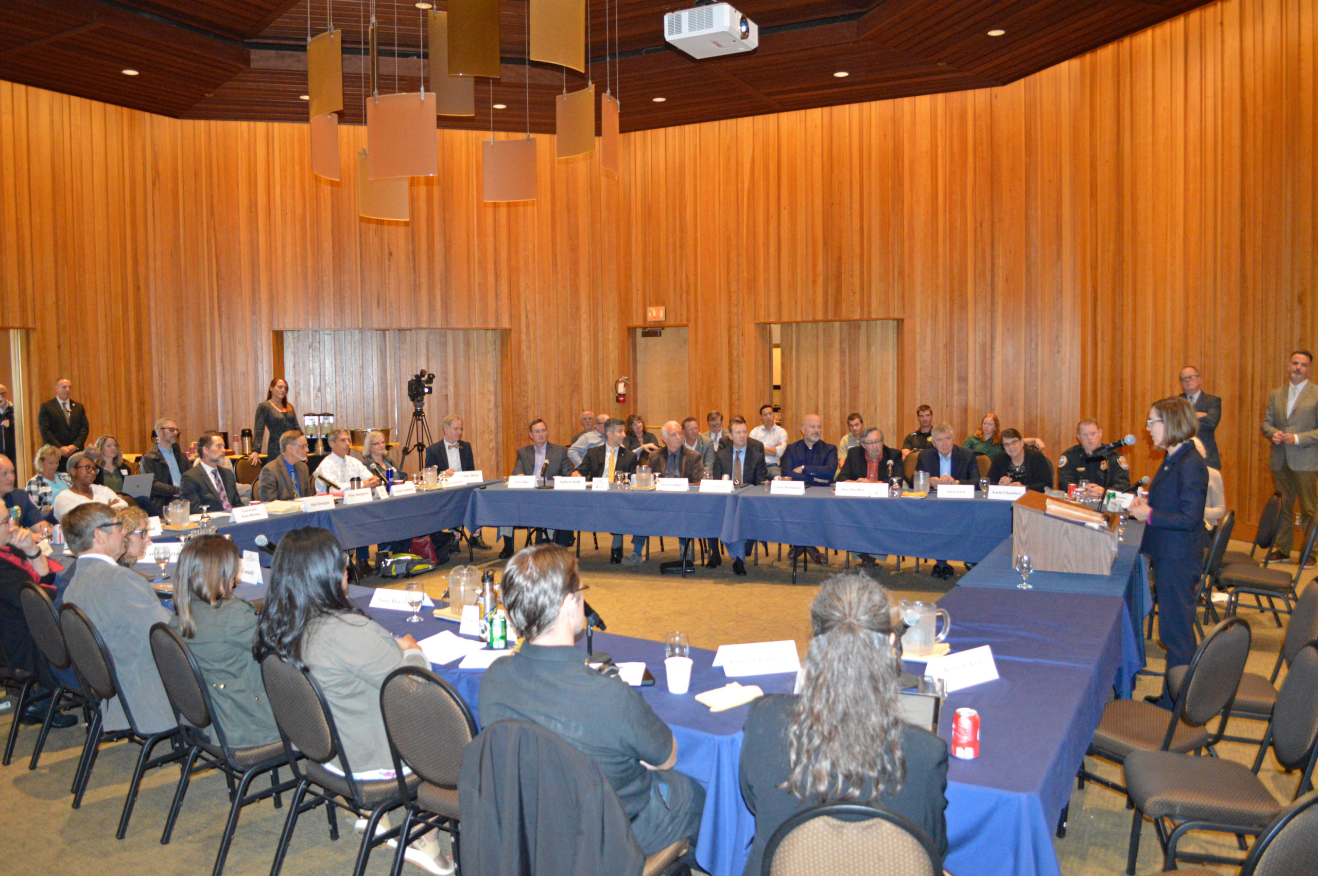 Professionals in the industry sit around a table at the Governor's Wildfire Council.