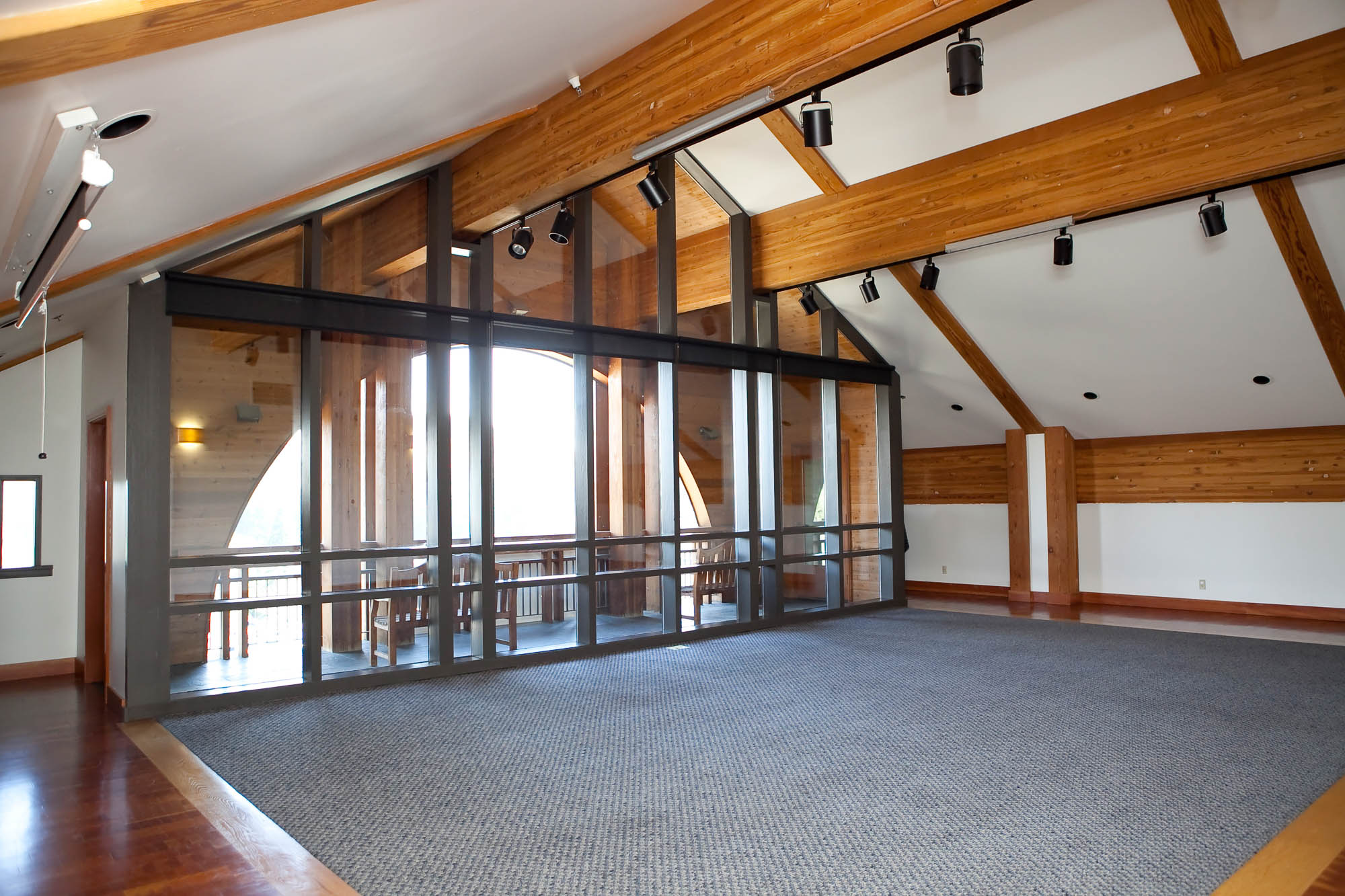 Room with wooden beams and large windows